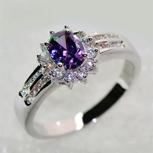 New 18k purple oval silver ring